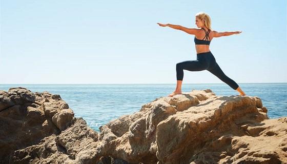 Yoga pose on an ocean cliff