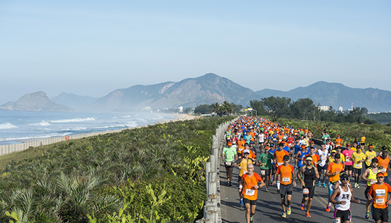 Runners with mountains and ocean in background