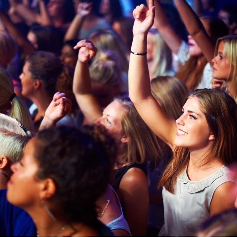 Concert crowd dancing