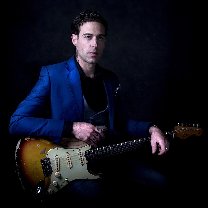 Dan Platansky with guitar